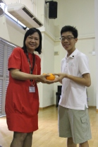 Student Council President exchanging oranges with our Principal Mrs. Lee