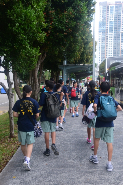 Recruits moving as stealthily as possible to the next location in the Amazing Race