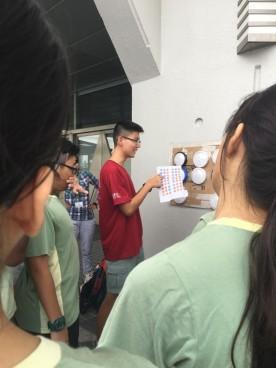A facilitator explaining the activity to recruits.